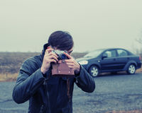 Tourist with a film camera Stock Photography