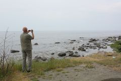 Tourist films at the Baltic Sea.Denmark Royalty Free Stock Photography