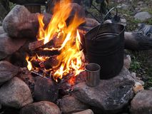 Tourist fire with a kettle and a mug Royalty Free Stock Image