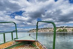 Tourist fishing boat ride pov with view of beautiful Ohrid old town, Macedonia. Tourist fishing boat ride pov with view of beautiful Ohrid old town in Macedonia Stock Image