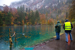 Tourist fishing for trout at Blausee lake stock images