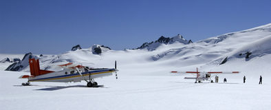 Tourist Flights - Mount Cook - New Zealand. Tourist flights landing by ski-plane on the upper snow fields of Mount Cook (Aorangi) on the south island of New Royalty Free Stock Photography