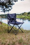 Tourist folding chair for rest and fishing in a hike. On the river lake Royalty Free Stock Photography