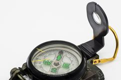 Tourist folding compass closeup on the white background. Tourist folding compass closeup on the white background; The necessary equipment for the traveler royalty free stock photography
