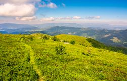 Tourist footpath through mountain ridge. Beautiful summer landscape under the gorgeous blue sky with some clouds Stock Image