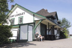 Tourist in Fort Langley. A tourist sits at the historic train station in Fort Langley, British Columbia, Canada stock images
