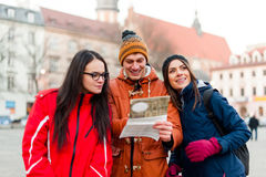 Tourist friends searching for directions royalty free stock photography