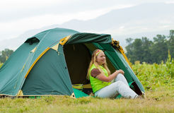 Tourist in front camp tent Stock Photos