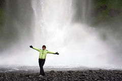Tourist in front of Seljalandsfoss waterfall Stock Image