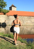 Tourist in front of Svihov castle stock image