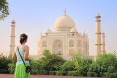 Tourist in front of Taj Mahal. Young tourist woman admires Taj Mahal Royalty Free Stock Images