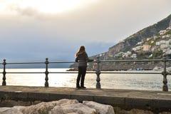 Girl on Amalfi Coast. Tourist girl admiring the sea on Amalfi Coast Royalty Free Stock Photography