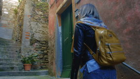 Tourist girl with a back pack in medieval city stock video