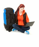 Tourist girl with backpack and laptop, full length Stock Photo
