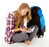 Tourist girl with backpack and map Stock Photography