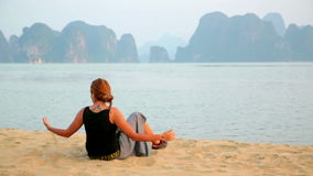 Tourist girl at beach,limestone view of halong bay,vietnam stock video
