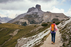 Tourist girl at the Dolomites Stock Images