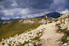 Tourist girl at the Dolomites royalty free stock photography