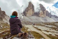 Tourist girl at the Dolomites Stock Photo