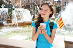 Tourist Girl drinking hot drink from disposable cup in Valencia, Spain. Royalty Free Stock Photography