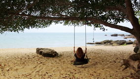 Tourist girl enjoying at swing at beach, sihanoukville, cambodia stock video