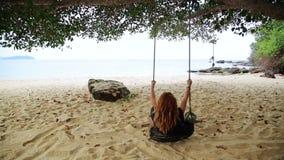 Tourist girl enjoying at swing at beach,sihanoukville,cambodia stock video