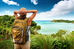 Tourist girl enjoying view of beautiful  hills and sea, travelin Royalty Free Stock Images