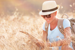 Tourist girl exploring map Royalty Free Stock Images