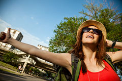 Tourist Girl Hitchhiking Royalty Free Stock Photos