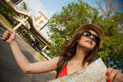 Tourist Girl Hitchhiking Royalty Free Stock Images