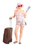 Tourist girl holding a ticket and suitcase Royalty Free Stock Photos