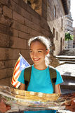 Tourist girl holding travel map in her hands looking up. Travel in Spain. Tourist girl holding travel map in her hands looking up. Hiking Stock Images