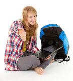 Tourist girl with laptop keeping thumb up Stock Photos