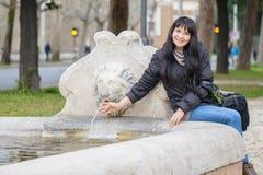 Tourist Girl at The Lion Fountain Royalty Free Stock Photo