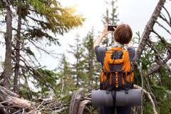 Tourist girl on a mountain stock photography