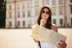 Tourist girl. With map wondering where she should go Stock Photography
