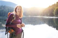 Tourist girl on a mountain lake stock photo