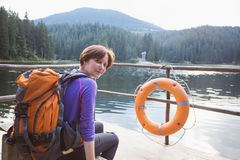 Tourist girl on a mountain lake. Tourist girl at the  mountain lake synevyr. Carpathians,  Ukraine stock photo