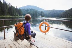 Tourist girl on a mountain lake. Tourist girl at the  mountain lake synevyr. Carpathians,  Ukraine royalty free stock photos