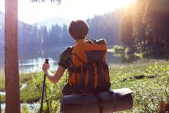 Tourist girl on a mountain lake. Synevyr on the sunset. Carpathians,  Ukraine stock photography