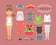 Tourist Girl Paper Doll with Clothes and Shoes. Cute Tourist Girl Paper Doll with Set of Fashionable Clothes and Shoes on Seamless Pink Background Royalty Free Stock Photography