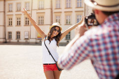 Tourist girl posing for her boyfriend Royalty Free Stock Images