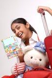 Tourist girl reading a traveler book Stock Image