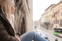 Tourist girl relaxing on European stairs Royalty Free Stock Photo