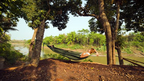tourist girl sleeping on hammock, luang prabang, laos Royalty Free Stock Photo