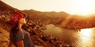 Tourist girl on sunset Stock Photo