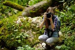 Tourist girl taking photos of landscape Stock Image