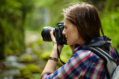 Tourist girl taking photos of landscape Royalty Free Stock Image