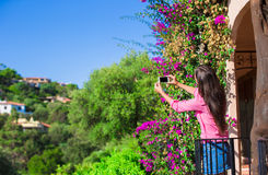 Tourist girl taking travel photos with smartphone on summer holidays. Young attractive tourist taking selfie photo with Royalty Free Stock Photos