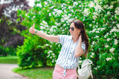 Tourist girl taking travel photos with smartphone on summer holidays. Young attractive tourist taking selfie photo with Royalty Free Stock Image
